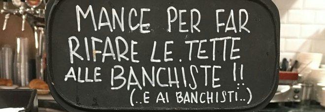 """""""Manche per rifare le tette alle banchiste"""", un cartello appeso in un bar di via Giubbonari."""